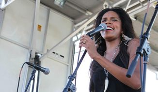 "In this Sept. 28, 2013 photo, New Orleans native and jazz vocalist Anais St. John performs at the Old Algiers Riverfest in New Orleans. St. John is opening the second weekend of the New Orleans Jazz and Heritage Festival on Thursday, May 1, 2014. Jazz Fest runs through Sunday with performances by Christina Aguilera, Chaka Khan, Lyle Lovett, Bruce Springsteen, Trey Songz, Troy ""Trombone Shorty"" Andrews, John Fogerty and Aaron Neville. (AP Photo/Stacey Plaisance)"
