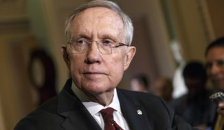 Senate Majority Leader Harry Reid of Nev. talks to reporters on Capitol Hill in Washington, Tuesday, April 29, 2014, as Congress returns from a two week recess. A long-shot Senate Democratic effort to raise the federal minimum wage seems doomed without needed votes to overcome a procedural blockade by most Republican senators, who say the measure would be too costly for employers.  (AP Photo)