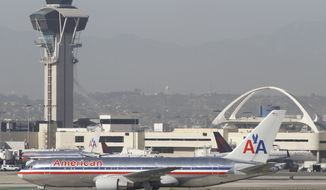 An American Airlines Boeing 767 awaits to take off at the Los Angeles International airport in Los Angeles on Wednesday, April, April 30, 2014. Flights from airports in the Los Angeles area were grounded for more than an hour Wednesday afternoon due to computer failure at an air traffic control facility in the region. (AP Photo)