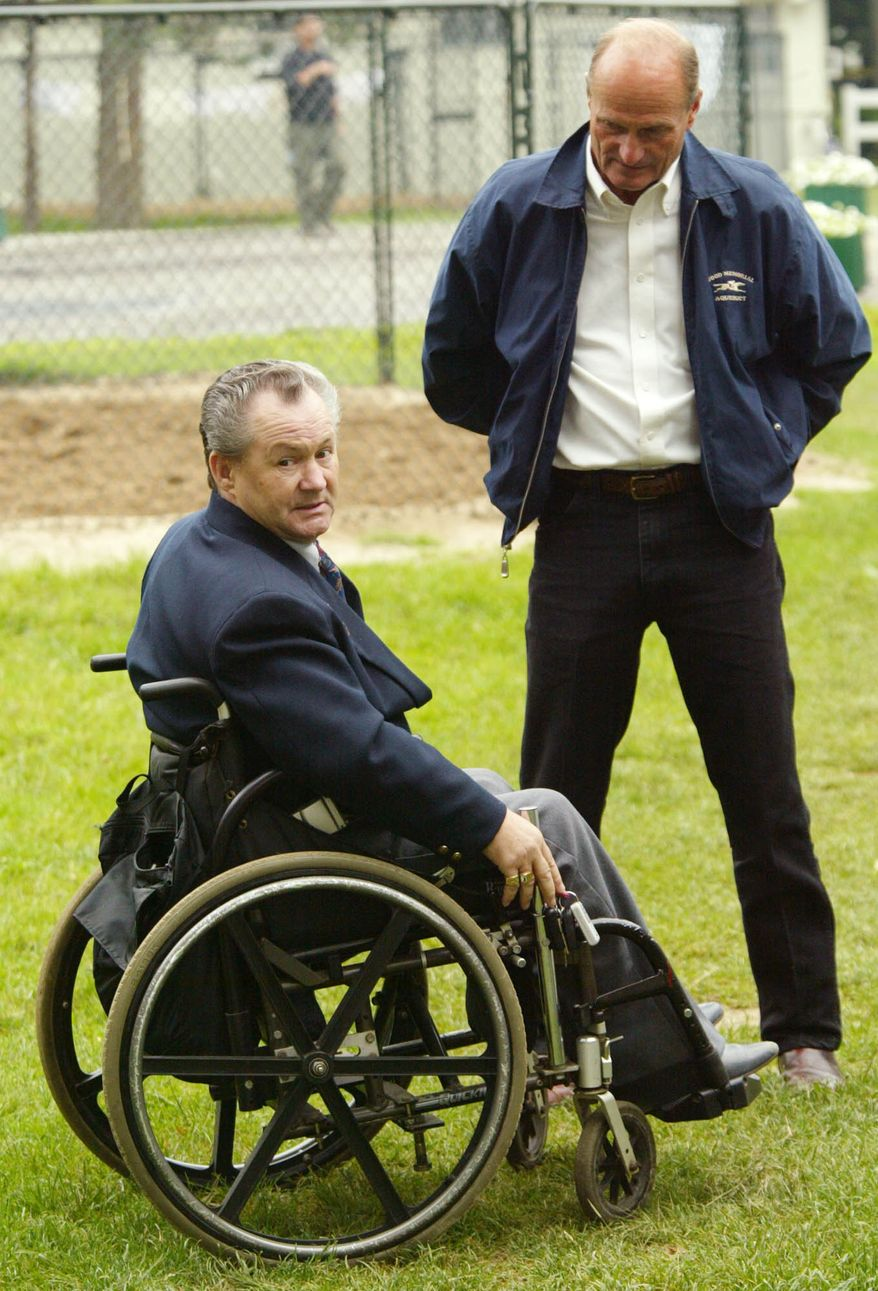 Triple Crown  contender Funny Cide's trainer Barclay Tagg, right, stands with Ron Turcotte, who rode 1973 Triple Crown winner Secretariat, at Belmont Park in Elmont, NY, Saturday, June 7, 2003.  (AP Photo/John Marshall Mantel)