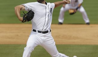Detroit Tigers pitcher Robbie Ray throws during the fourth inning of a spring exhibition baseball game against the Toronto Blue Jays in Lakeland, Fla., Tuesday, March 11, 2014. (AP Photo/Carlos Osorio)