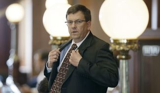 Iowa House Speaker Kraig Paulsen looks on before before debate in the Iowa House, Wednesday, April 30, 2014, at the Statehouse in Des Moines, Iowa. (AP Photo/Charlie Neibergall)