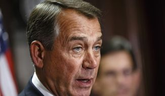 House Speaker John Boehner of Ohio, accompanied by GOP leaders, speak, to reporters following a Republican strategy meeting on Capitol Hill in Washington, Tuesday, April 29, 2014. Boehner said Rep. Michael Grimm, R-N.Y., did the right thing by stepping down from the the House Financial Services Committee after he was indicted Monday with evading taxes. (AP Photo)