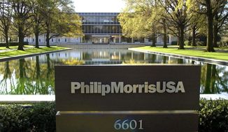 "FILE - In this November 2003 file photo is the reflecting pool in front of the Philip Morris USA headquarters in Richmond, Va. An Illinois appellate court on Tuesday, April 29, 2014 reinstated a decade-old $10.1 billion verdict in a class-action lawsuit against Phillip Morris USA that found the nation's biggest cigarette maker misled customers about ""light"" and ""low tar"" designations. Philip Morris swiftly decried Tuesday's ruling by a three-judge panel of the Mount Vernon-based 5th District Appellate Court, saying it would ask the Illinois Supreme Court to review the matter.  (AP Photo/ Richmond Times-Dispatch, P. Kevin Morley)"