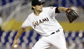 Miami Marlins starting pitcher Nate Eovaldi throws during the first inning of a baseball game against the Atlanta Braves, Wednesday, April 30, 2014, in Miami. (AP Photo)