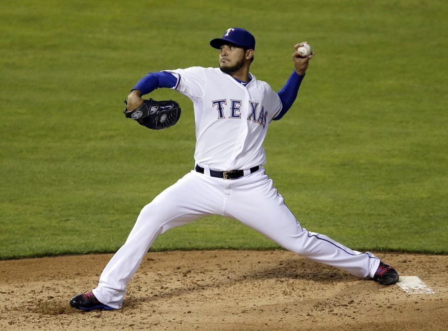 Texas Rangers' Martin Perez works against the Oakland Athletics in the fourth inning of a baseball game, Tuesday, April 29, 2014, in Arlington, Texas. (AP Photo/Tony Gutierrez)