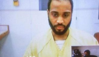 In this image from video Fredrick K. Young, 25, of Detroit, listens to the Court Magistrate during his arraignment in 36th District court in Detroit, Wednesday, April 30, 2014. Young and his accomplice Ferlando D. Hunter are charged with the July, 2012 homicides of Westland residents Jacob Kulda, 18, and Jourdan Bobbish, 18. A nearly two-year investigation culminated with two Michigan men being charged with robbing, torturing and killing two suburban Detroit teens in 2012. Young and Hunter are charged with first-degree murder, torture, armed robbery, unlawful imprisonment and having a firearm during a felony. (AP Photo/Detroit Free Press, Jarrad Henderson)