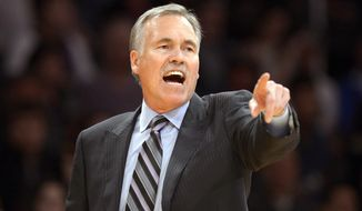 FILE - In this Feb. 28, 2014, file photo, Los Angeles Lakers head coach Mike D'Antoni gestures during the second half of an NBA basketball game against the Sacramento Kings in Los Angeles. Lakers spokesman John Black confirmed D'Antoni's resignation Wednesday, April 30. (AP Photo/Mark J. Terrill, File)
