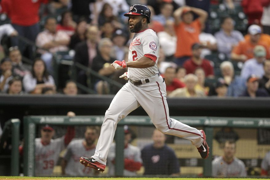 Washington Nationals' Denard Span hits a triple and scores on a fielding error by Houston Astros right fielder George Springer during the third inning of a baseball game, Wednesday, April 30, 2014, in Houston. (AP Photo/Patric Schneider)