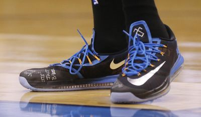 """Oklahoma City Thunder forward Kevin Durant has the phrase """"It's Just B-Ball"""" written on his shoes as the Thunder face the Memphis Grizzlies in Game 5 of an opening-round NBA basketball playoff series in Oklahoma City, Tuesday, April 29, 2014. (AP Photo)"""
