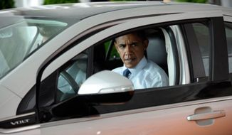 ** FILE ** President Obama inspects of Chevy Volt. (Associated Press)