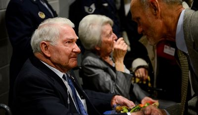 Staff Sgt. John M. Fox and his wife Lucille, center, become emotional as people greet him and thank him for his service after he receives the Prisoner of War Medal by Air Force Chief of Staff Gen. Mark A. Welsh III along with seven other World War II era U.S. Army Air Forces personnel during a ceremony at the Pentagon, Arlington, Va., Wednesday, April 30, 2014. (Andrew Harnik/The Washington Times)