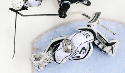 Los Angeles Kings' Jonathan Quick, bottom, allows a goal on a shot from San Jose Sharks' Matt Irwin as James Sheppard (15) celebrates next to the Kings' Jake Muzzin (6) during the second period in Game 7 of an NHL hockey first-round playoff series on Wednesday, April 30, 2014, in San Jose, Calif. (AP Photo/Marcio Jose Sanchez)