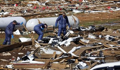 Tyson Foods workers continue tornado cleanup at Wilkes Farm,d in Noxapater, Miss., Wednesday, April 30, 2014. The farm raises broilers for Tyson and each house has 28, 500 chickens. Several poultry raising farms near Louisville were damaged or destroyed by tornadoes Monday. (AP Photo/Rogelio V. Solis)