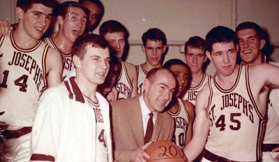 This undated photo provided by Saint Joseph's University shows the school's basketball coach Jack Ramsay, center, when his team won his 200th career game. Ramsay, a Hall of Fame coach who led the Portland Trail Blazers to the 1977 NBA championship before he became one of the league's most respected broadcasters, has died following a long battle with cancer. He was 89. (AP Photo/Saint Joseph's University)