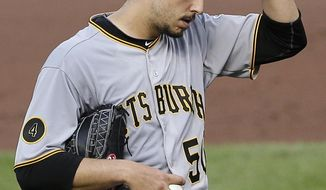 Pittsburgh Pirates starting pitcher Charlie Morton adjusts his cap before an at-bat against Baltimore Orioles' Steve Pearce in the sixth inning in the first baseball game of a doubleheader on Thursday, May 1, 2014, in Baltimore. Pearce drove in a run during his at-bat and Morton was relieved. (AP Photo/Patrick Semansky)