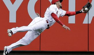 Cincinnati Reds center fielder Billy Hamilton makes a diving catch on a fly ball hit by Milwaukee Brewers' Carlos Gomez in the first inning of a baseball game, Thursday, May 1, 2014, in Cincinnati. (AP Photo/Al Behrman)