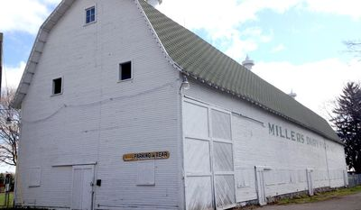 ADVANCED FOR RELEASE MONDAY, MAY 5, 2014 The Miller Farm Dairy barn is just one of the original buildings on the State Street property in Eaton Rapids, Mich. (AP Photo/Lansing State Journal, Rachel Greco)