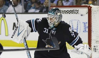 San Jose Sharks' Antti Niemi, of Finland, deflects a shot on goal against the San Jose Sharks during the second period in Game 7 of an NHL hockey first-round playoff series on Wednesday, April 30, 2014, in San Jose, Calif. (AP Photo/Marcio Jose Sanchez)