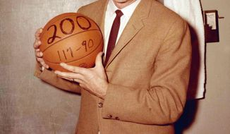 This undated photo provided by Saint Joseph's University shows the school's basketball coach Jack Ramsay when his team won his 200th career game. Ramsay, a Hall of Fame coach who led the Portland Trail Blazers to the 1977 NBA championship before he became one of the league's most respected broadcasters, has died following a long battle with cancer. He was 89. (AP Photo/Saint Joseph's University)