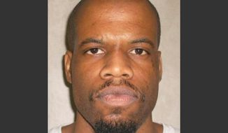 FILE - This June 29, 2011 file photo provided by the Oklahoma Department of Corrections shows Clayton Lockett. Oklahoma prison officials halted the execution of Lockett Tuesday, April 29, 2014,  after the delivery of a new three-drug combination failed to go as planned. Oklahoma Gov. Mary Fallin said Lockett had an apparent heart attack more than 40 minutes after the start of the execution. (AP Photo/Oklahoma Department of Corrections, File)