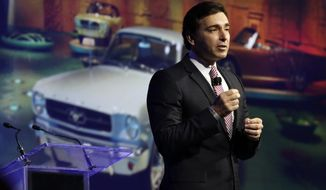 FILE - In this April 16, 2014 file photo, Ford Motor Company Chief Operating Officer Mark Fields delivers his keynote address at the New York International Auto Show, in New York's Javits Convention Center. Ford says CEO Alan Mulally will retire July 1 and be replaced by Fields. (AP Photo/Richard Drew, File)