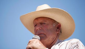 ** FILE ** Rancher Cliven Bundy speaks at a news conference near Bunkerville, Nev., Thursday, April 24, 2014. (AP Photo/Las Vegas Review-Journal, John Locher)