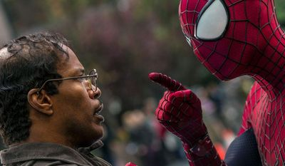 """Max Dillon, an electrical engineer played by Jamie Foxx, squares off against Spider-Man, played by Andrew Garfield, in """"The Amazing Spider-Man 2."""" (Sony Pictures Via Associated Press)"""