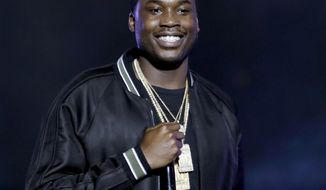 FILE - In this Sept. 28, 2013 file photo, Meek Mill performs at the BET Hip Hop Awards, in Atlanta. The Philadelphia rapper Mill lost his civil-rights case against city police Thursday, May 1, 2014, over a 10-hour traffic stop that he called racially motivated. (AP Photo/David Goldman, file)