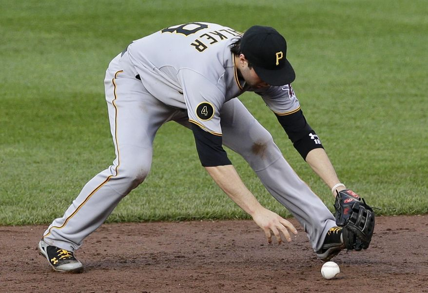 Pittsburgh Pirates second baseman Neil Walker bobbles Baltimore Orioles' Steve Clevenger's ground ball in the sixth inning of the first baseball game of a doubleheader on Thursday, May 1, 2014, in Baltimore. Clevenger was safe at first on Walker's fielding error. Baltimore won 5-1. (AP Photo/Patrick Semansky)