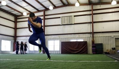 FILE - In this Friday, Feb. 14, 2014, file photo, Gallaudet defensive lineman Adham Talaat runs the 40-yard-dash at TEST Sports Clubs in Martinsville, N.J. Talaat has overcome being deaf to reach the doorstep of the NFL. After starring at Gallaudet University, working out at Test Parisi Football Academy and posted impressive numbers at his Pro Day, the talented defensive end is hopeful he'll get a call when the NFL draft kicks off next week. (AP Photo/Mel Evans,file)