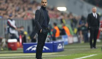 Bayern head coach Pep Guardiola watches  the Champions League semifinal second leg soccer match between Bayern Munich and Real Madrid at the Allianz Arena in Munich, southern Germany, Tuesday, April 29, 2014. (AP Photo/Matthias Schrader)