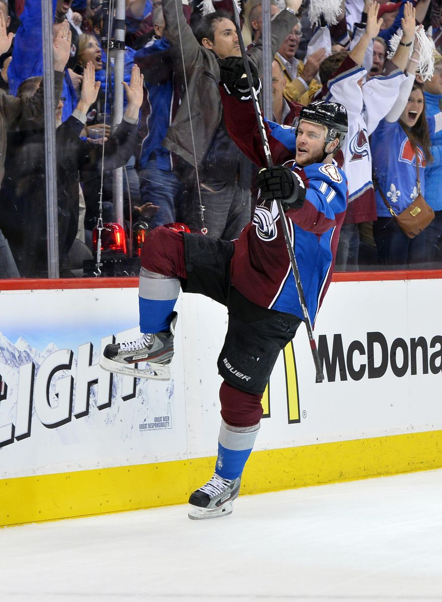 Colorado Avalanche left wing Jamie McGinn celebrates a goal against the Minnesota Wild in the first period during Game 7 of an NHL hockey first-round playoff series on Wednesday, April 30, 2014, in Denver. (AP Photo/Jack Dempsey)