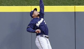 Milwaukee Brewers center fielder Carlos Gomez catches a fly ball hit by Cincinnati Reds' Joey Votto in the first inning of a baseball game, Thursday, May 1, 2014, in Cincinnati. (AP Photo/Al Behrman)
