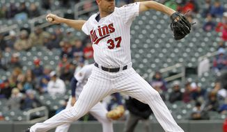 Minnesota Twins starting pitcher Mike Pelfrey (37) delivers to the Los Angeles Dodgers during the first inning in the first baseball game of a doubleheader in Minneapolis, Thursday, May 1, 2014. (AP Photo/Ann Heisenfelt)