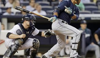 Seattle Mariners' Robinson Cano follows through on an RBI single during the third inning of a baseball game against the New York Yankees, Thursday, May 1, 2014, in New York. (AP Photo/Frank Franklin II)