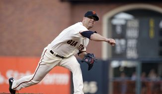 San Francisco Giants starting pitcher Tim Hudson throw against the San Diego Padres in the first inning of a baseball game Wednesday, April 30, 2014, in San Francisco. (AP Photo)