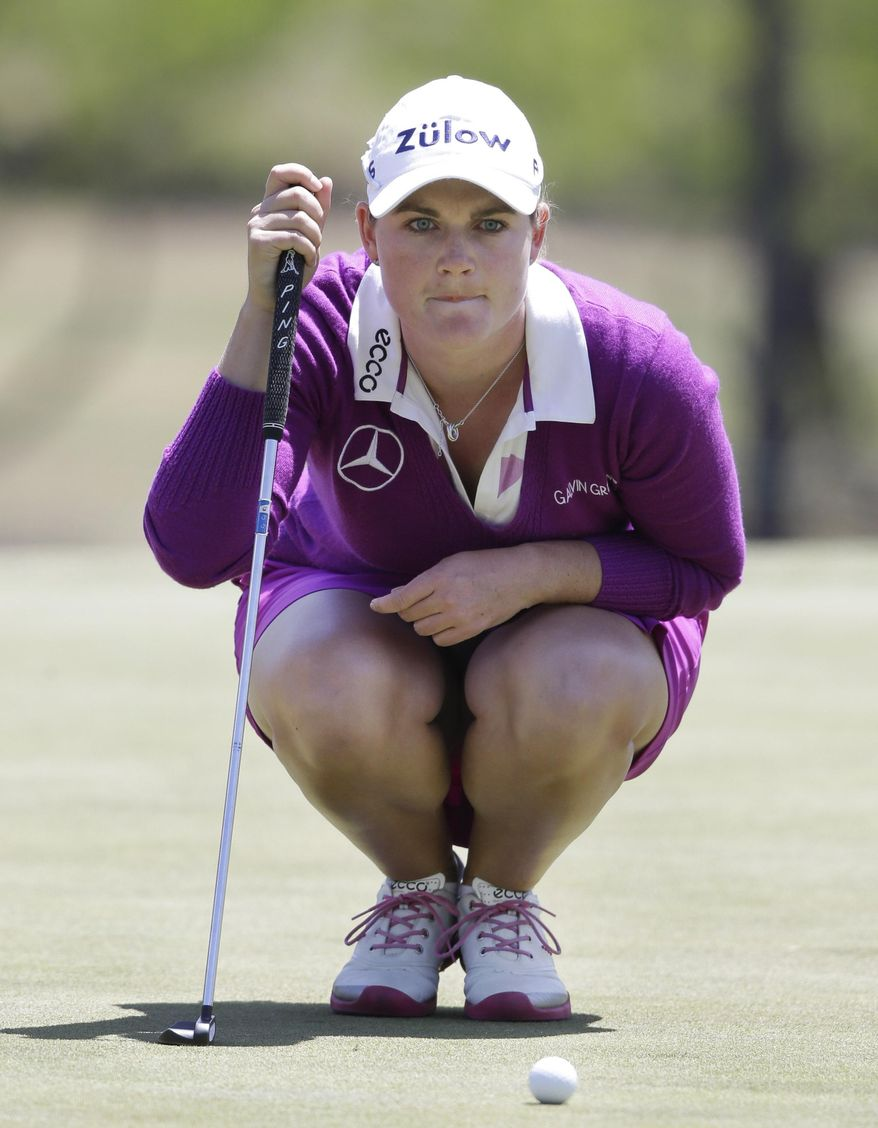 Caroline Masson, of Germany, lines up a putt on the ninth green during the first round of the North Texas LPGA Shootout golf tournament at the Las Colinas Country Club in Irving, Texas, Thursday, May 1, 2014. (AP Photo/LM Otero)