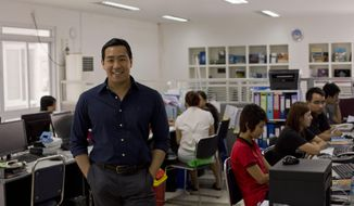 In this April 12, 2014 photo, Nay Aung, founder of Oway company poses in his office, Yangon, Myanmar. Nay Aung, a 34-year-old Stanford graduate and former business operations and strategy manager at Google Inc., is among a vanguard of overseas-trained professionals who have returned to Myanmar to find both opportunities and challenges.  (AP Photo/Gemunu Amarasinghe)