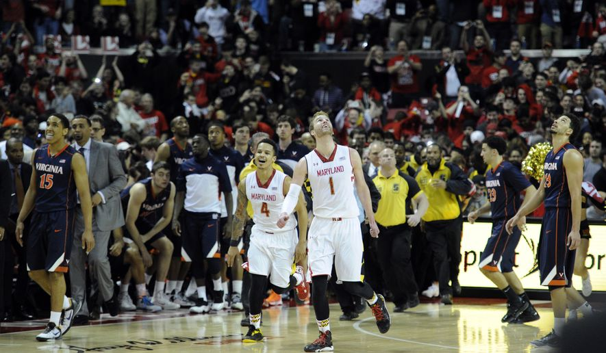 Maryland guard Seth Allen (4) and Evan Smotrycz react after they defeated Virginia in overtime of an NCAA college basketball game 75-69, Sunday, March 9, 2014, in College Park, Md. Virginia guard Malcolm Brogdon (15) and London Perrantes (23) look on.  (AP Photo/Nick Wass)