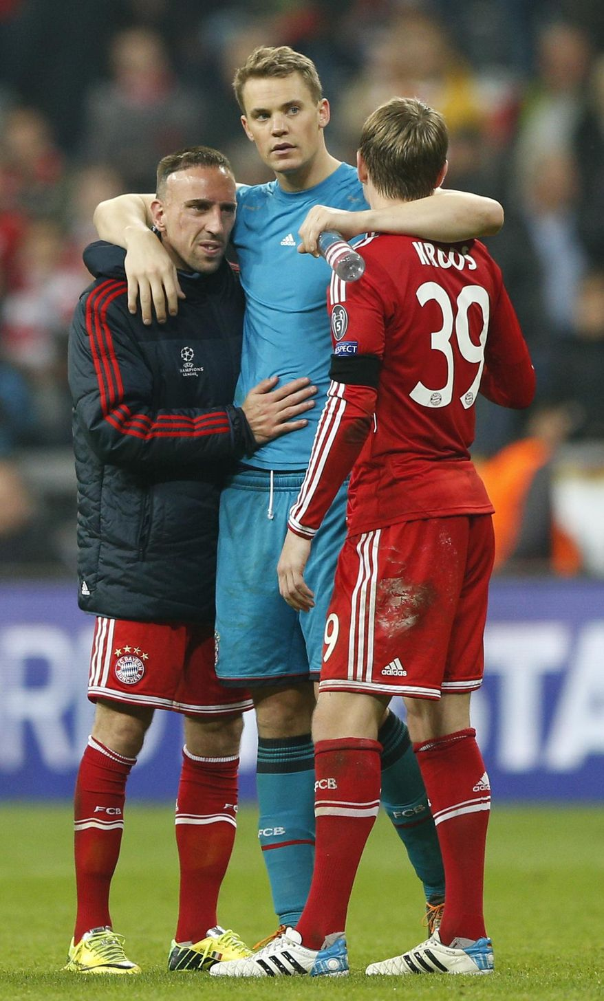 Bayern goalkeeper Manuel Neuer comforts his teammates Franck Ribery, left, and Toni Kroos, right, after losing the Champions League semifinal second leg soccer match between Bayern Munich and Real Madrid at the Allianz Arena in Munich, southern Germany, Tuesday, April 29, 2014. (AP Photo/Matthias Schrader)