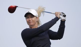 Suzann Pettersen, of Norway, watches her tee shot on the seventh green during the first round of the North Texas LPGA Shootout golf tournament at the Las Colinas Country Club in Irving, Texas, Thursday, May 1, 2014. (AP Photo/LM Otero)