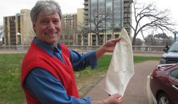 ** FILE ** Democratic state Rep. Brett Hulsey, a candidate for governor, displays a Ku Klux Klan-style hood he sewed and had planned to hand out at the Wisconsin Republican Party convention as a symbol of what he says is the GOP's racists policies on Thursday, May 1, 2014, in Madison, Wis. (AP Photo/Scott Bauer)
