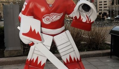 A big bobblehead statue of Detroit Red Wings goalie Jimmy Howard stands headless in Campus Martius park on Thursday, May 1, 2014 in Detroit, Mich. after it was vandalized. (AP Photo/The Detroit News, David Coates)