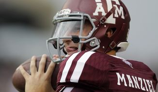 FILE - In this Sept. 7, 2013, file photo, Texas A&M quarterback Johnny Manziel throws a pass before an NCAA college football game against the Sam Houston State in College Station, Texas. Manziel could be the answer to Cleveland's prayers at quarterback. The polarizing and popular Texas A&M star will likely be available when the Browns pick fourth in next week's NFL draft.  (AP Photo/David J. Phillip, File)