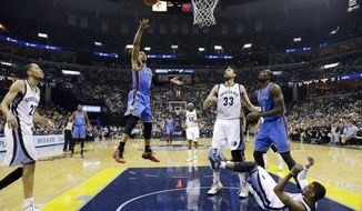 Oklahoma City Thunder guard Russell Westbrook (0) shoots as Memphis Grizzlies guard Mike Conley falls to the floor in the first half of Game 6 of an opening-round NBA basketball playoff series Thursday, May 1, 2014, in Memphis, Tenn. (AP Photo/Mark Humphrey)