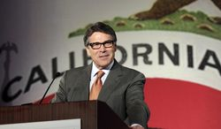 """FILE - In this Oct. 5, 2013 file photo Texas Gov. Rick Perry gives the keynote speech at the California Republican Party convention in Anaheim, Calif. California Gov. Jerry Brown said Friday, May 2, 2014, it appears there was little California could have done to keep Toyota from moving its U.S. headquarters and about 3,000 jobs to Texas, saying """"change is inevitable."""" Perry said his state offered Toyota $40 million in incentives. (AP Photo/Reed Saxon, File)"""