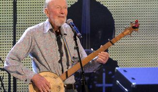 FILE- In this Sept. 21, 2013 file photo, Pete Seeger performs on stage during the Farm Aid 2013 concert at Saratoga Performing Arts Center in Saratoga Springs, N.Y. Seeger, who died on Jan 27, 2014 at age 94, will be honored with a few early event on Saturday, May 3, 2014, what would have been his 95th birthday. Suggestions for memorializing the singer/activist ranger from renaming a park in his home town to naming the new bridge that will replace the Tappan Zee bridge across the Hudson River in New York after him. (AP Photo/Hans Pennink, File)