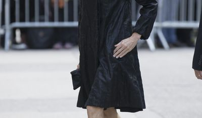 Actress Meg Ryan arrives at St. Bartholomew's Church for a memorial service for fashion designer L'Wren Scott, Friday, May 2, 2014, in New York. Scott committed suicide on March 17 in her Manhattan apartment. (AP Photo/John Minchillo)