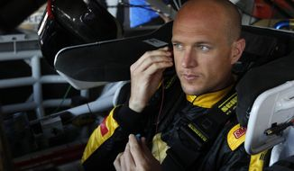 Driver Josh Wise prepares for practice as he sit in his car for Sunday's Aaron's 499 NASCAR auto race at Talladega Superspeedway on Friday, May 2, 2014, in Talladega, Ala. (AP Images Photo/Butch Dill)